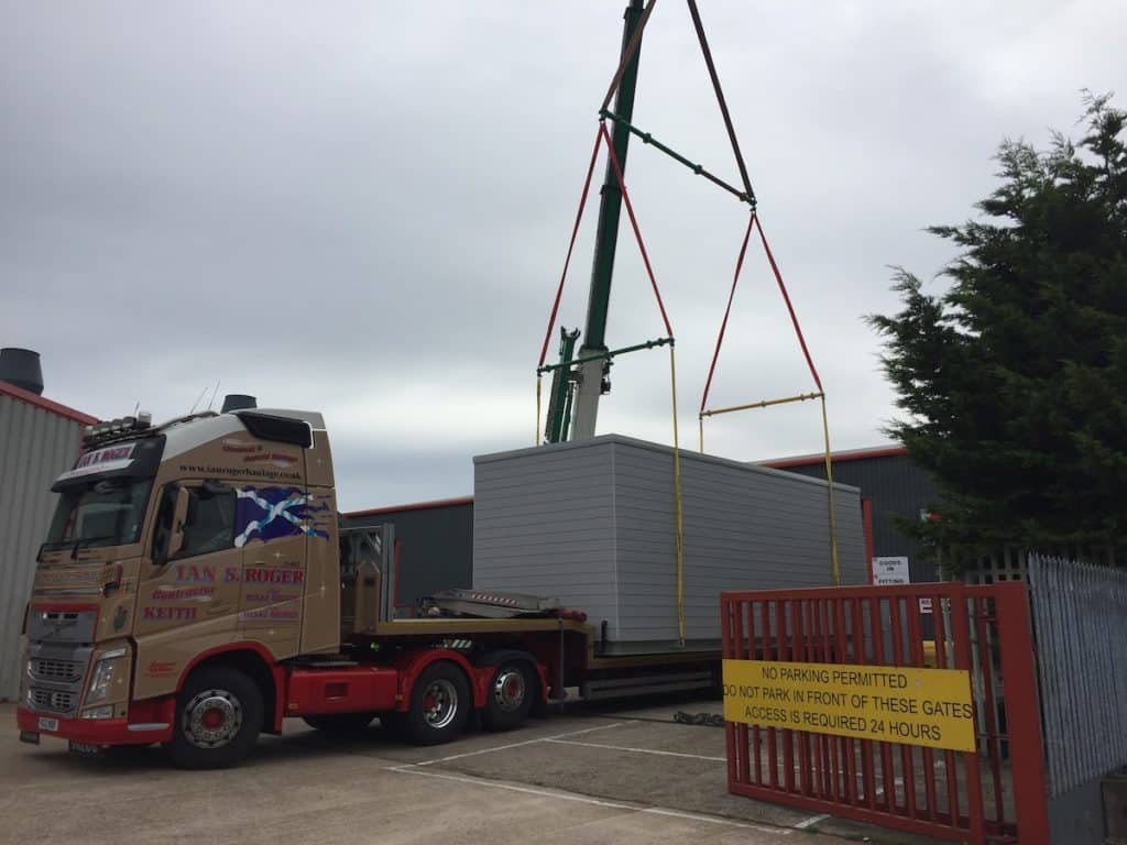 Lifting the completed unit onto the back of the lorry for delivery
