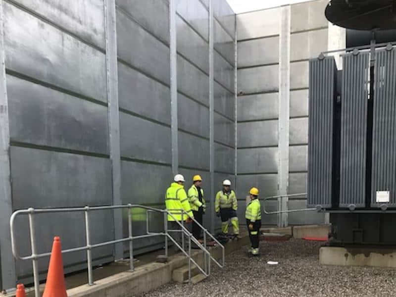 The Kimpton Acoustics team on site as the Acoustic Barriers are dismantled with the decommissioned transformer to the side working around impressed voltage