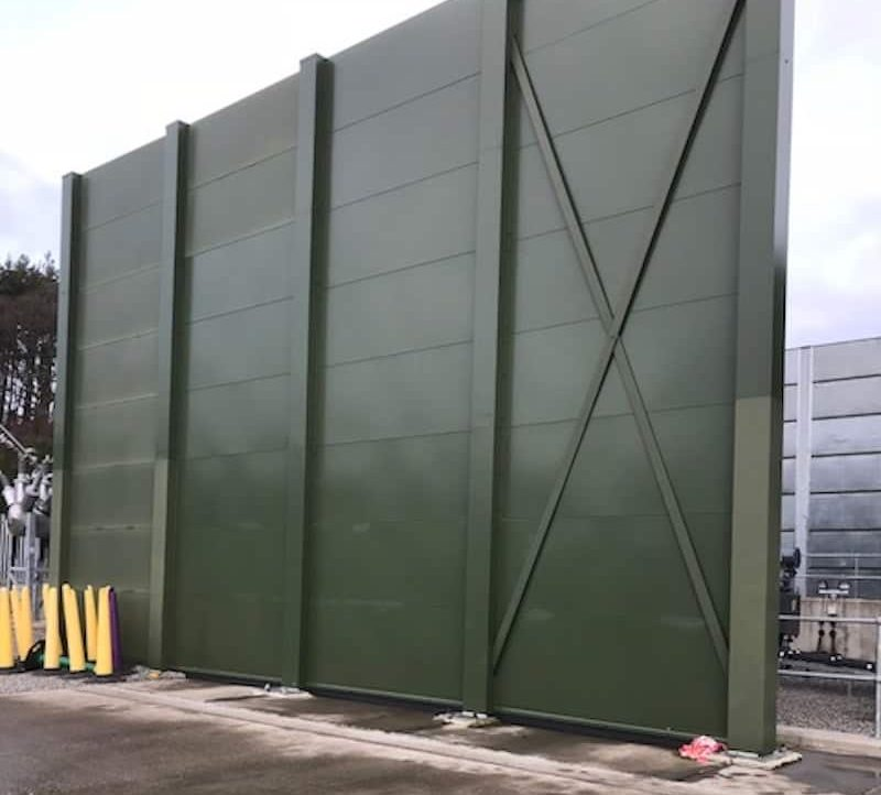 With the new transformer in place, the new acoustic barriers are installed to enclose and reduce the transformer noise impressed voltage